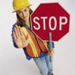 woman with a roadblock stop sign