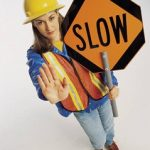 worker with a slow sign